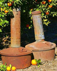 If you grew up in what once was the Orange capital of the world you would know what a smudge pot was too! LOL - I see these and I feel home!