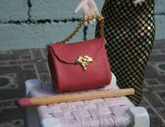 Leather handbag (non-opening) with gold trim. 1/12 scale dollhouse miniature