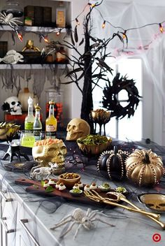 Create a Halloween spread worthy of the most sophisticated ghosts and goblins with a combination of snacks, drinks, and edgy decor. Every detail, from the mix of black and gold to the eerie animal skeletons works together in this festive yet stylish setup Spooky Halloween, Halloween Food For Party, Halloween Birthday, Holidays Halloween, Halloween Treats, Happy Halloween, Halloween Sandwich, Target Halloween Decor, Halloween Entertaining