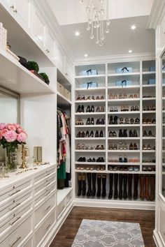 Traditional Closet with Chandelier, Custom walk-in closet, Fancy trellis gray rug, High ceiling, Hardwood floors