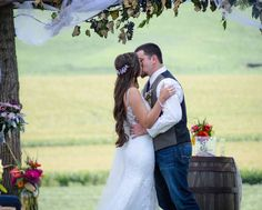 Rustic Farm wedding. This bridal gown is perfect for the setting. Photo courtesy of Brittany Peiffer Photos