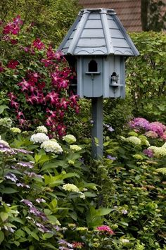 Classic garden of hydrangeas and clematis surrounding classic bird house Garden Gates, Garden Art, Garden Design, Home And Garden, Dream Garden, Bird Houses, Garden Inspiration, Bird Feeders, Beautiful Gardens