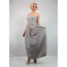 Sterling silk strapless gown. Silver bustle gown. Late 1950's Early 1960's.