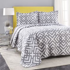 This Adrienne Vittadini quilt set is great to layer into your bedding as a coverlet or use alone in warmer weather. This quilt set is reversible and an easy way to update your room.