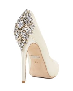Kiara Embellished Peep-toe Pump - Style # : KIARA - IVORY - $245.00 - Kiara by Badgley Mischka. Kiara is a satin platform pump with a glamorous vintage-inspired decoration at the back of the heel. The evening shoe features a sturdy platform and peep-toe. The showstopper on this style is the rhinestone decoration; the sophisticated sparkle is sure to stand out. - Heel height: 4 3/4 inches. 1 inch platform. - Note: The heel decoration is applied by hand, so there might be some variation with…