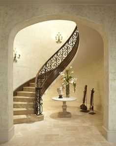 Staircase swathed in coral stone. | Elegant Residences