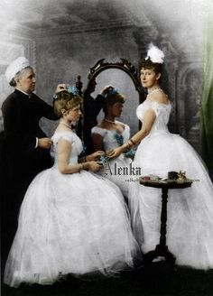 Princess Alix of Hesse getting ready for her first ball with the help of her nanny and elder sister Elizabeth, Grand Duchess of Russia.
