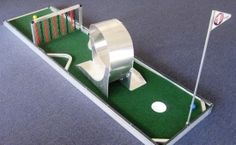 "Miniature Golf Party Game Rental - Everyone loves to play miniature golf and now you can include a ""CRAZY"" mini-golf hole for your next party, event, or trade show booth! Miniature Golf game rental available for rent in San Diego"