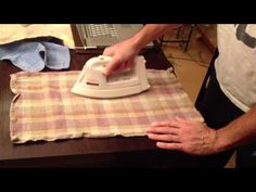 Remove white heat stains from wood furniture using an iron.  **I tried it and it works perfectly.  Set on lowest steam setting, check as you iron, wipe moisture immediately and oil or polish the area when finished.*