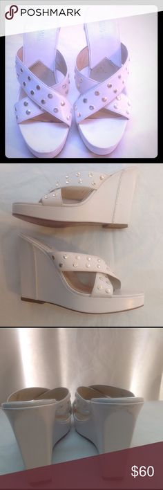 "Michael Kors studded wedge. 8M White wedge sandals, silver studding on criss cross straps, gentle wear to soles. Slight scuff marks on back top of heel not very noticeable when worn, can be touched up with shoe polish. 5"" wedge size 8M Michael Kors Shoes Sandals"