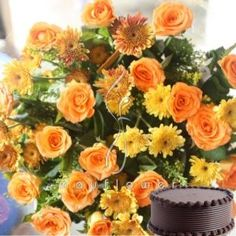 A hand bunch of bright colors along with 1/2 kg chocolate cake. Send Colorful Roses With Cake Hand Bunch to any city in India through May Flower. Send Fresh flowers thru local florists in India to deliver fresh flowers same day delivery. Order Colorful Roses With Cake Hand Bunch flowers to India. Buy and send  to India same day delivery.  delivered to all cities in India.