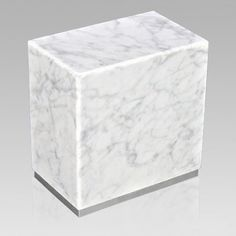 The Dignity Silver Bianco Carrera Marble Urn is assembled from real natural quarried stone. The urn features a stainless steel trim and has a stainless steel or 24k gold plated decoration option. The bottom has felt to protect the surface were the urn stands. This wonderful natural stone urn will create a dignified resting place for eternity to come. Memorial Urns, Funeral Memorial, Cremation Urns, Cremation Jewelry, Casket, Carrera, Natural Stones, Decorative Plates, Marble