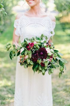 Forest & Field Creative: I used in season flowers for all of my arrangements. Here we have hops, dahlias, roses, bay leaf, and blackberries. Photo: www.anthemphotography.com