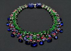 "The Tutti Frutti Necklace by Cartier One of Cartier's most famous pieces, the ""Hindu necklace"" was commissioned by Vogue-honored socialite and Singer sewing machine heiress Daisy Fellowes in 1936. It's made of dozens of rubies, emeralds, and diamond beads set in platinum and thirteen sapphires. This was the necklace that helped kick off Cartier's ""Art Deco"" craze"