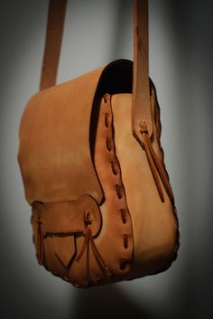 """Simple Leather Purse: Here are instructions for a simple leather purse. No sewing is required, just some leather cutting (which is easiest if you have access to a laser cutter) and some lacing. The purse is about 9"""" x 9"""" x 3"""" when finished."""