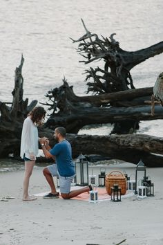 A romantic beach proposal with lots of props! || Photography by graceful-light.com || Selected by Finepointwedding.com