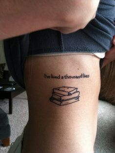 """I've lived a thousand lives"" books tattoo. I love the idea :)"