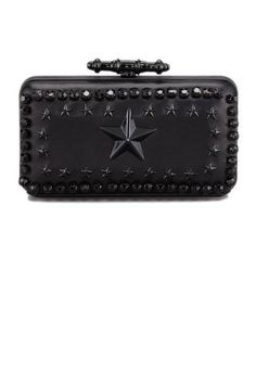 *gasp* omg...LOVE! Clutch from Givenchy.