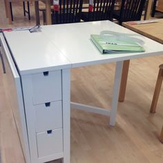 Ikea Norden Gateleg table, for sewing table. Both sides fold down so you can have half the table or none at all. There are also 6 small drawers on the side. Diy Crafts Useful, Diy Crafts Desk, Craft Table Ikea, Craft Desk, Craft Rooms, Folding Sewing Table, Norden Gateleg Table, Small Space Solutions, Sewing Rooms