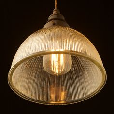 Ribbed Glass Dome Pendant with brass lampholder and gallery. The old world Holophane type ribbed glass shade shows off the warm colour of the Edison bulb.