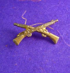 This Vintage Military Crossed Rifle Pin / brooch is crafted in Brass and would make a great holiday gift for a collector. This is the Time to be thinking of the upcoming holidays and what better way then that something for the men that have everything! This would be a great idea because it is Vintage and not something you can buy Everyday. OR perhaps Just A perfect addition to a collection. Boxed for gift giving; gift wrapped on request. Maker: unknown Material: brass Size: see photo Weight…