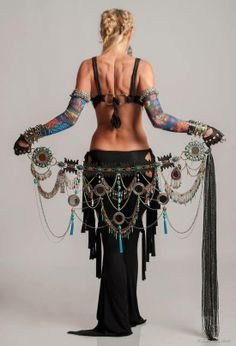 """Tribal belly dance belt, i love unique belts like this. And I want some of those """"tattooed"""" sleeves!"""