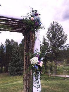 blue, purple and pink arch piece Enchanted Florist Taos - Taos, NM Flower Shop