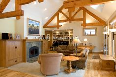 Living room with wood beams in custom designed home by Zimmer Builders LLC