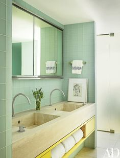 A drawing by Willem de Kooning rests atop the honed-limestone counter in the master bath; the sink fittings are by Vola from Hastings Tile & Bath | archdigest.com