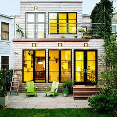 """Plan for low upkeep """"Out back, our top priority was a no-maintenance exterior,"""" says King. He clad the addition in white cedar shingles know..."""