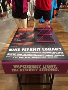 Nike Flyknit Lunar 2 - Impossibly Light. Incredibly Strong - retail table sports shoe display.