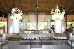 An sleek sushi station as the room centerpiece for this May wedding reception in The Pavilion
