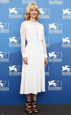 Simply stylish: Jones, 36, wore a white mid-length dress which featured sheer panels with ...