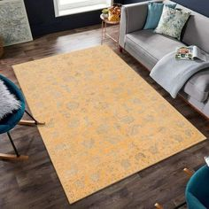 Add cheer and warmth to a room by displaying this unique Gold Oriental rug. The rug's fun, festive appearance is a result of its bright gold, cool grey motif design! #Goldrug #Orientalrug #Arearug