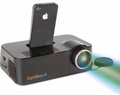 Iphone video projector a really cool idea for those who live with their iphone, iphones are becoming even more multi functional, soon we wont need any extras as the ihpone will do it all. this also charges whilst projecting which is a big help.