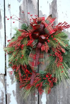 Christmas Wreath, Mixed Pine, Red Berries, Plaid Bow, Red Metal Ribbon Red Metal Jingle Bells via Etsy.