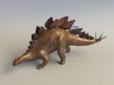 "Gordon Uyehara Thagomizer (Stegosaurus) Bronze and copper metal clay on paper clay - 5 1/4 x 2 1/4 x 1 3/8"". See it in person at the Gallery at Ward Centre: www.gwcfineart.com"