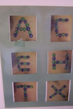 "Glass nugget tactile letters by Eleanor Luken ("",) lowercase please!!!!!"