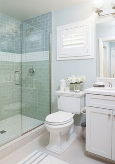 coastal bathroom with aqua blue subway tile | AGK Design Studio