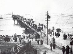 Santa Monica Pier opens in 1909 with thousands of visitors wanting to see the new pier