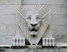 Stone Lion - One of two lions which flank the entrance to the Iowa Masonic Library and Museum, a building which falls into the category of stripped classical Art Deco. Photo by Buck Cash.