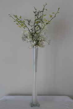 Eiffel Tower vase with orchids http://www.wanakaweddingflowers.co.nz/gallery.php