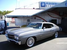 Here are a few pics of the Twin Turbo 1970 Chevelle SS. grey pro touring protouring chrome wheels red black grey interior