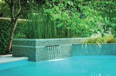 Beautiful water feature.  Zen Style Re-birth Makes For Award-winning Pool - Award Winners, Designers, Natural Metals, Pools, Swimming, Landscaping, Placing Concrete - Pool & Spa News