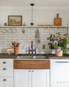 The soft effect of the handmade-look subway tile is in perfect harmony with the other charming elements of this whimsical kitchen by @ispydiy. ✨ Upper Cabinets, Kitchen Cabinets, Kitchen Sinks, Kitchen Reno, Kitchen Dining, Kitchen Remodel, Dining Room, Stainless Steel Farmhouse Sink, Copper Kitchen