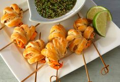 These amazing appetizers feature marinated shrimp wrapped in tender puff pastry. Served on skewers, they're perfect for dipping in the flavor-packed sauce!