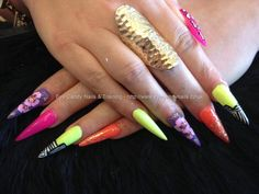 Stiletto nails with multi coloured gel polish and nail art