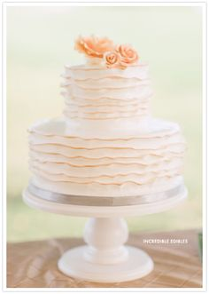 ivory and peach wedding cake  Oh how we loved the peach trimmed ruffles in this cake by Incredible Edibles. It suited this charming Southern wedding perfectly.