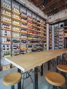 Beros & Abdul Architects converted a historic building in Bucharest into a wine shop modelled after a library, complete with 'reference desk' and tasting room.