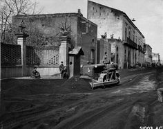 American soldiers clearing volcanic ash from the streets of an Italian town after the 18-23 March 1944 eruption of  Mount Vesuvius. (US National Archives)